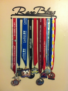 I've since added a second hanger bar to hold my -- as it says -- race bling.
