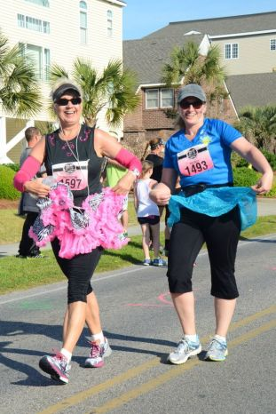 Jane and me having fun along the Myrtle Beach Diva Half Marathon course in 2014